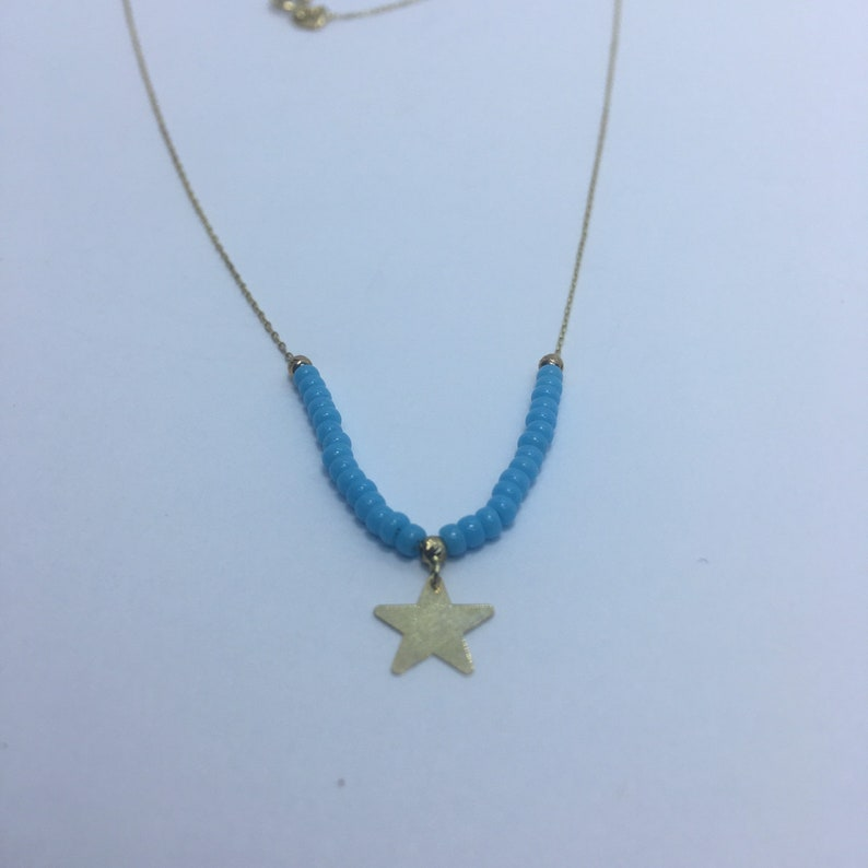 Handmade 18k gold star Necklace With Turquoise Stone.