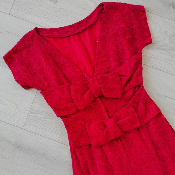 1950s  red lace wiggle dress with bows in the back