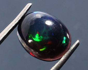 13.50 cts natural VVS top neon  multi color play Ethiopia  black opal cabochon