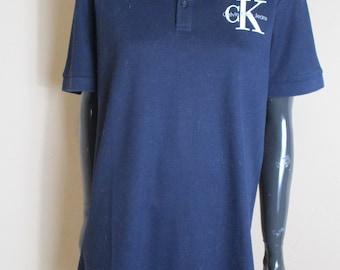 Men's vintage Calvin Klein polo shirt in navy, Made from Cotton.