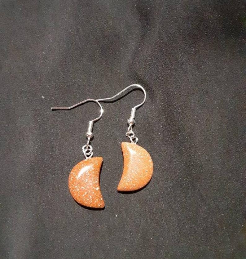 Goldstone crescent moon shaped earrings
