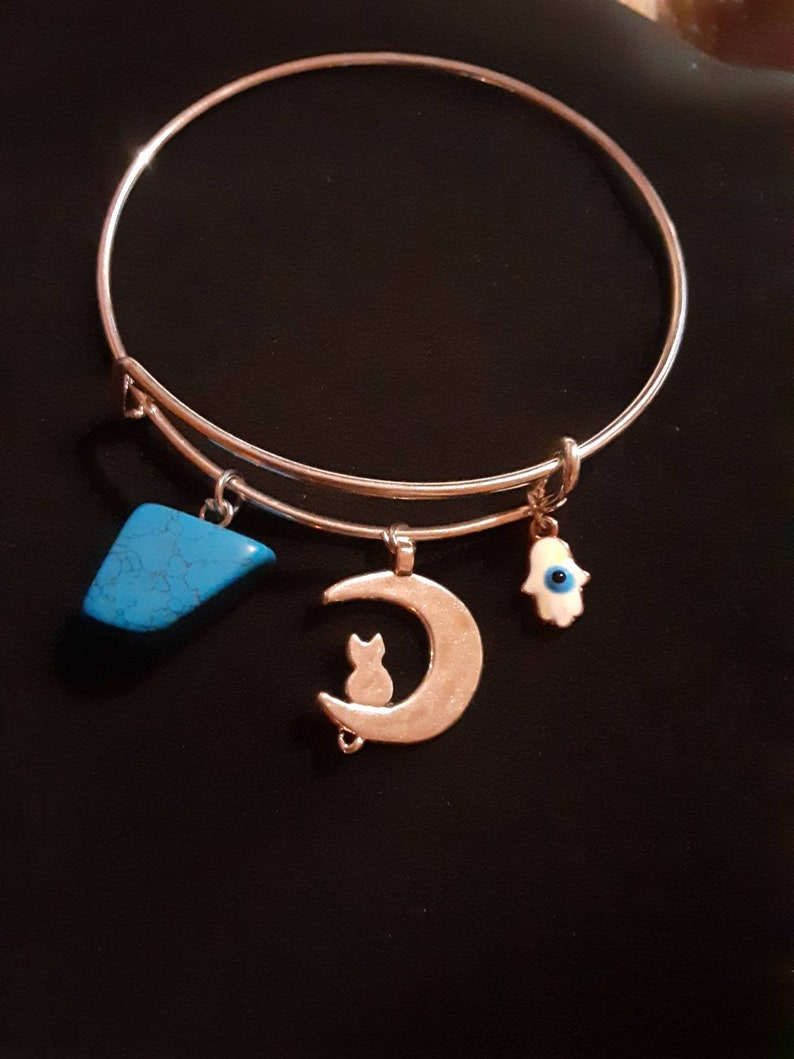 Cuffcharm bracelet stainless steel cat and moon with polished blue howlite and white hasma charm