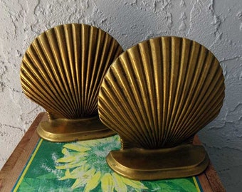 Antique Set of Brass Bookends with an old fashion scene