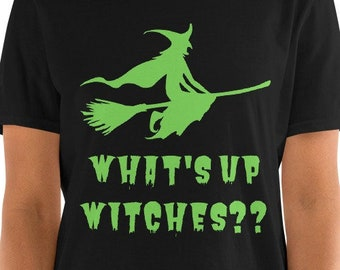 What's Up Witches?? - Funny Halloween Unisex T-Shirt with the quote under a green witch on a broomstick