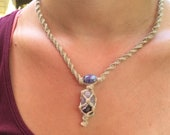 Natural hemp necklace with banded amethyst pendant