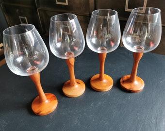 Four wooden walking glasses
