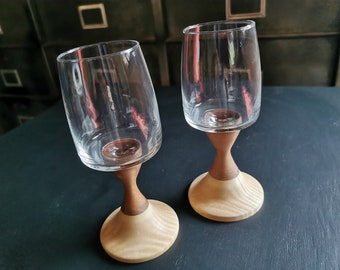 Two wooden walking glasses