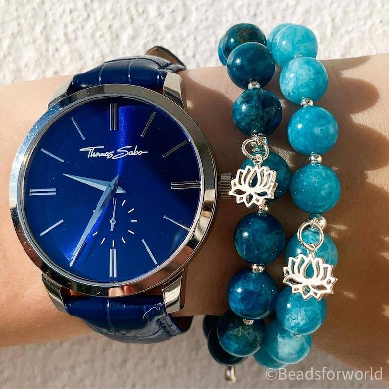 Signature gemstone bracelet with sterling silver lotus pendant