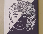 Purple and white painted portrait with sunflowers.