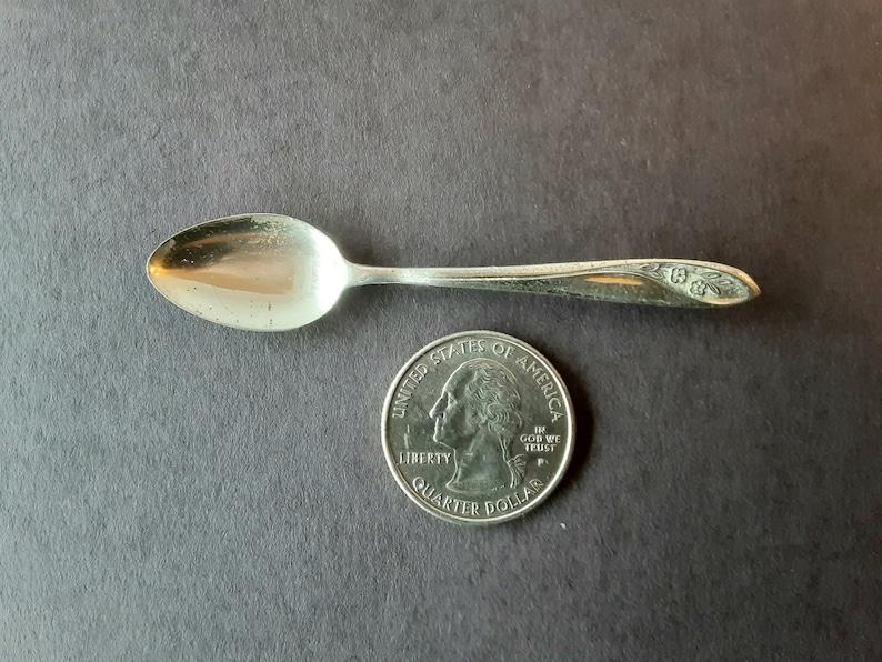 Silver spoon pin