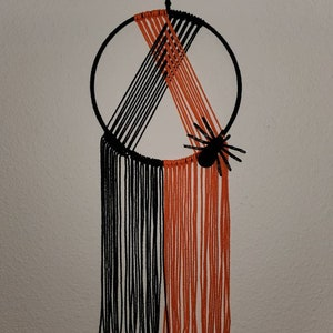 Halloween macrame orange and black wall hanging with spider