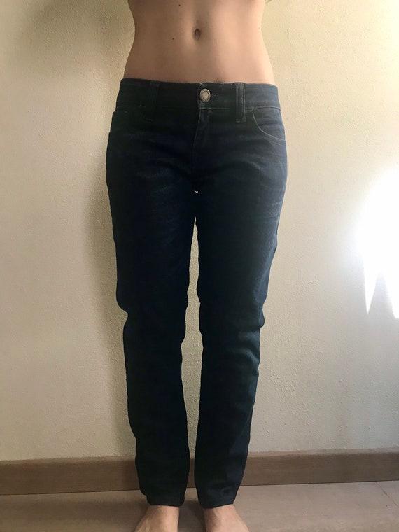Jean Paul Gaultier blue jeans.