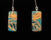 Ancient Series Earrings with handmade polymer clay layered designs giving an aged, worn look