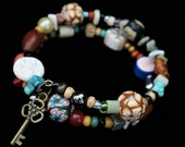 Freedom Bracelet (with handmade polymer clay beads, found and recycled beads telling the story of freedom and empowerment of women)