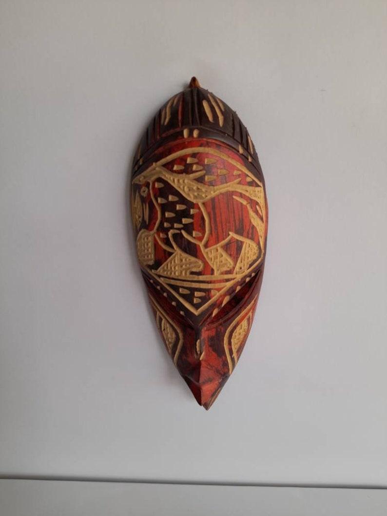 African lion,walking lion,African mask,wall hanging,Wooden lion mask,carved lion,design lion,sculpture,colourful mask,Ghana artefacts