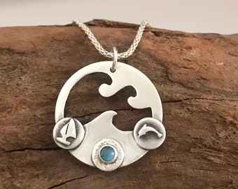 Silver wave pendant with blue topaz. Seascape pendant with blue topaz.