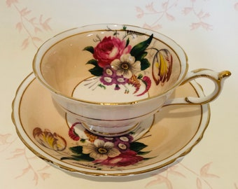 PARAGON Double Warrant Pale Peach Teacup and Saucer with Bouquet of Flowers