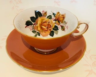 ROYAL GRAFTON Burnt Orange Teacup and Saucer with Peach/Orange Rose