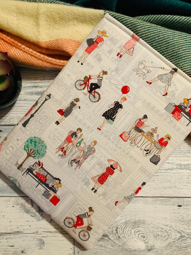 Pamper Ladies Reading on Bench Shopfronts Book Sleeve  image 0