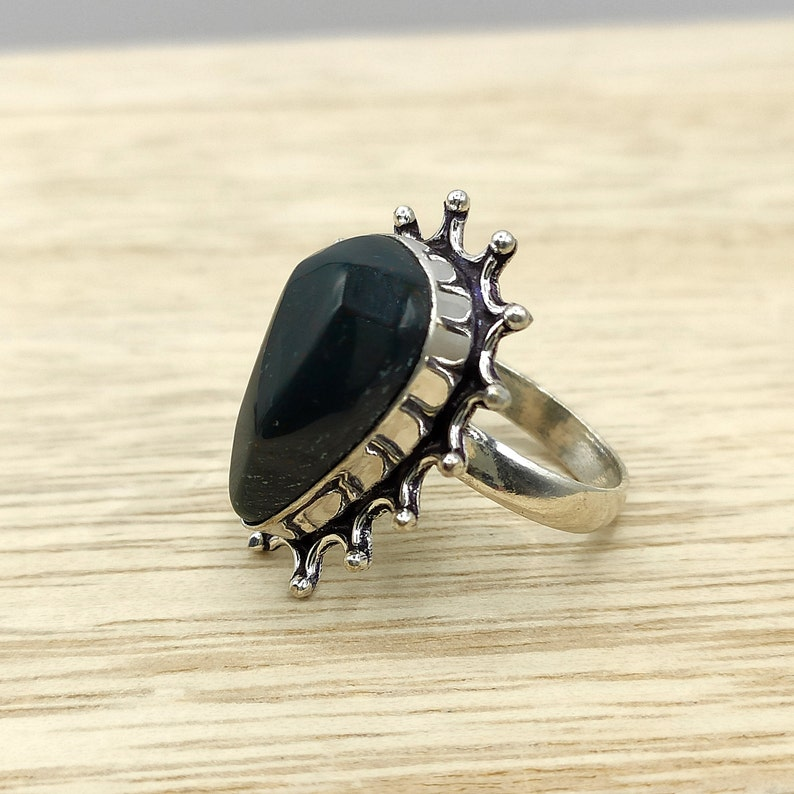 Original ethnic bloodstone ring with character design