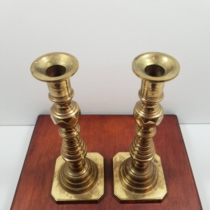 Antique pair of late 19th century beehive pushup brass candlesticks brass candlesticks