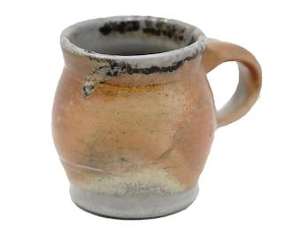 Espresso mug with soda-fired surface