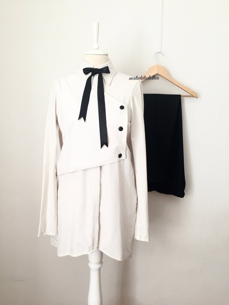 collared shirt minimal button up top long sleeves cream white button down tunic with collar neckline double layer blouse with buttons