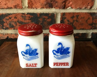Vintage salt and pepper milk glass shakers with red lids made in USA