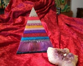 Large resin pyramid. Layered pyramid. Decoration for the house.