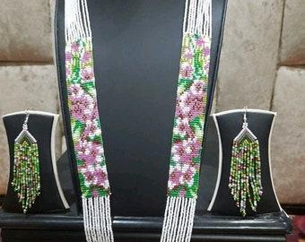 Wide beaded choker with a traditional Slavic pattern Orange flowers ethnic amulets Black background boho jewelry