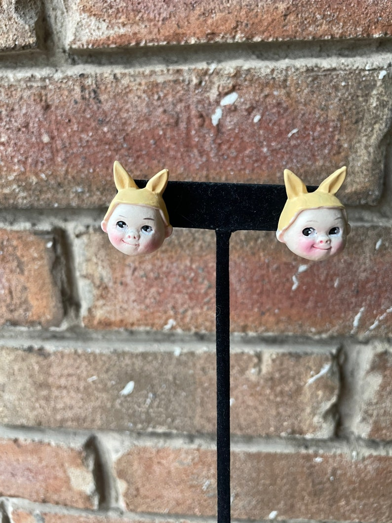 Doll with bunny hat earrings