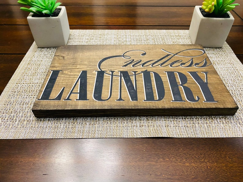 industrial laundry sign endless laundry in black and white chalk paste Solid wood Dimensions 12x10 inches.