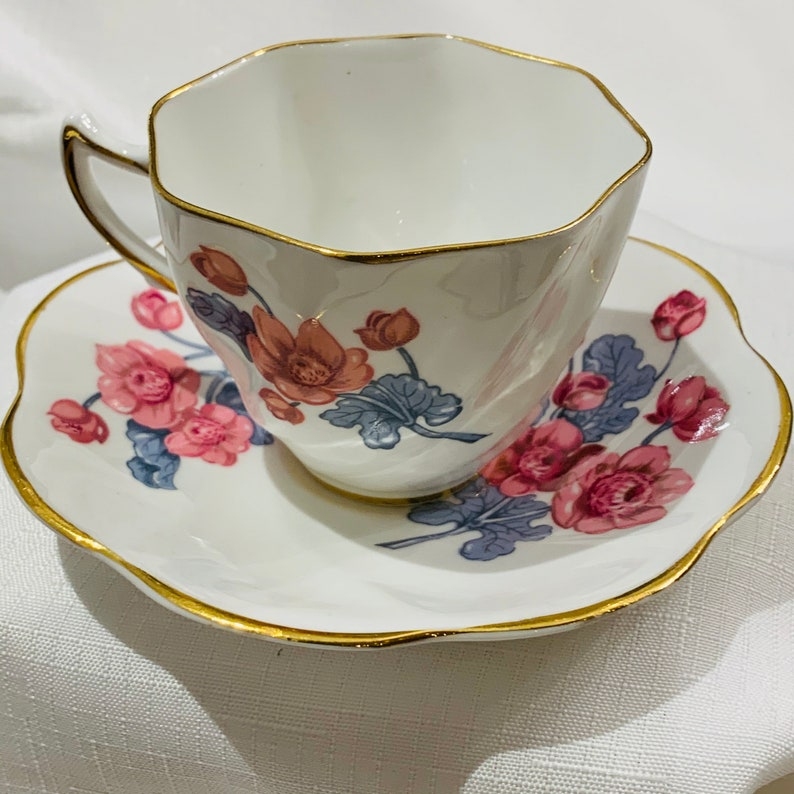 Vintage Clare bone china scalloped floral teacup and saucer set