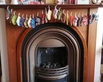 Elf Stocking Christmas Advent Calendar. Hand knitted with 24 colourful stripy elf boots. Made to Order by the end of October 2021.
