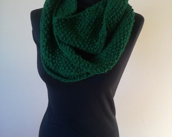 Bottle green seamless infinity scarf. Hand knitted in an acrylic wool in moss stitch. Warm and cosy for the winter weather