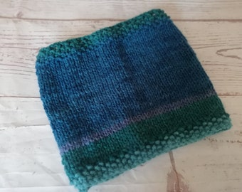Aqua colours of the sea snood / scarf. Knitted in acrylic wool. Great for dog walking and wearing as a mask if needed