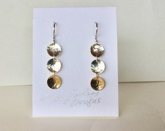 Joyful lightweight dangling mixed metal earrings. Sterling Silver and 14k Gold filled hammered discs with Sterling Silver ear wires.