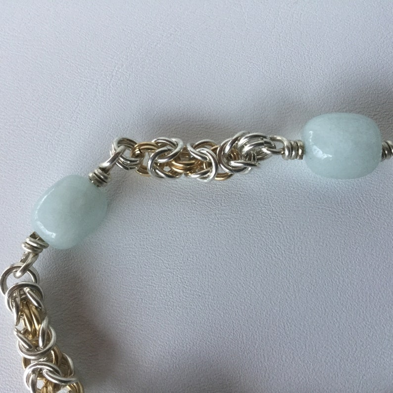 Sterling Silver and 14k Gold filled Byzantine chain bracelet with Aquamarine beads and lobster claw clasp.