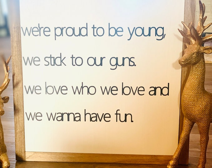 We're proud to be young, We stick to our guns Sign