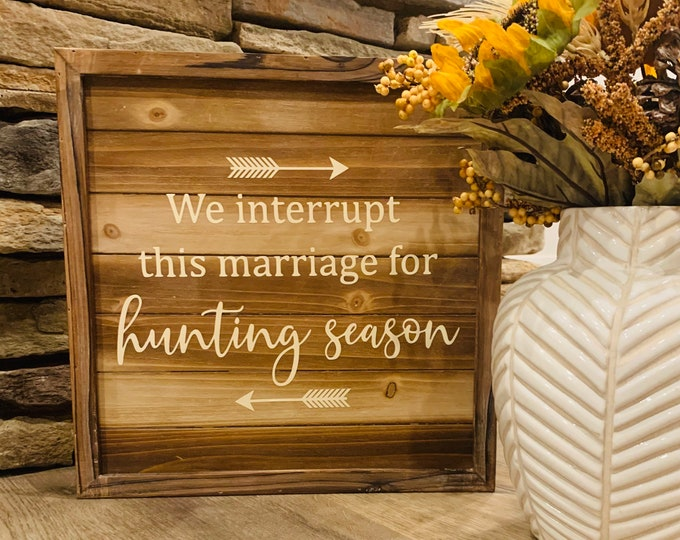 We interrupt this marriage for hunting season sign