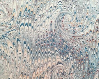 Blue curl over non pareil patterned hand marbled paper, perfect for bookbinding