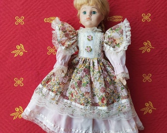 Antique porcelain doll in a pink lace dress, Moonflower dolls collection