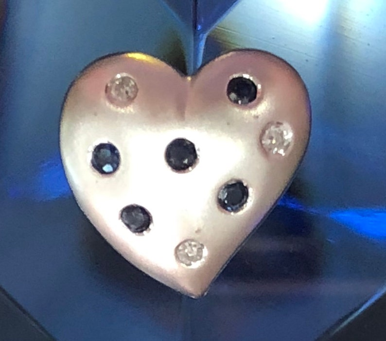 Heart Pendant 10k white gold with 5 Blue Sapphires and 3 diamonds.