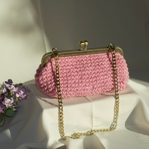 Handmade PRIMULA pochette made of denim fabric with machine embroidery detail
