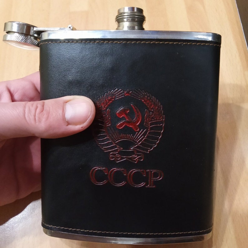 Faux leather wrapper. A flask in a black case with a coat of arms Soviet army flask