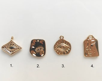 High quality gold-plated face/eye charms (1 per pack)