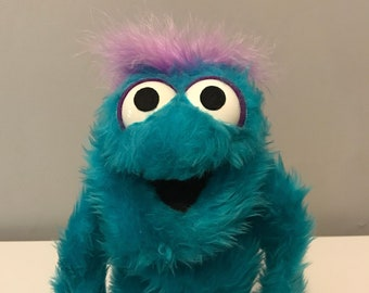 Turquoise Blue Fuzzy Puppet.