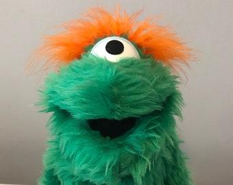Green Fuzzy Puppet. One Eye.