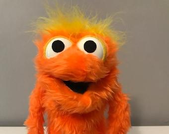 Orange Fuzzy Puppet.