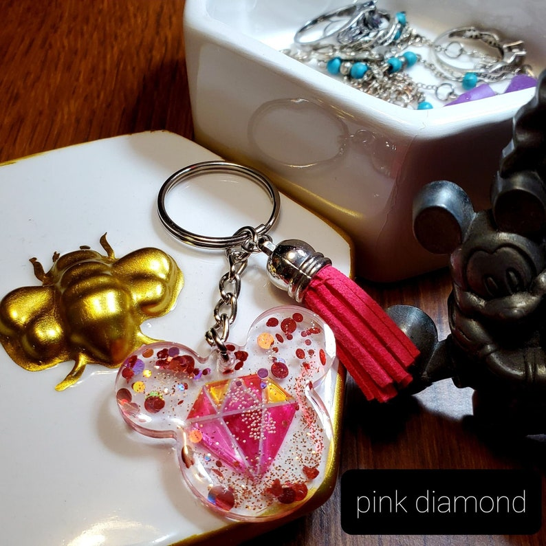 disney pink and gold diamond with pink tassel mickey head resin keychain back pack pull tab
